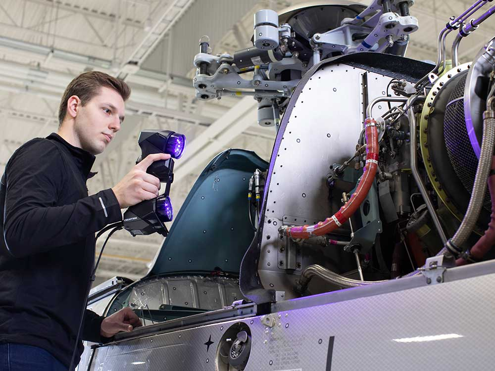 man holding handyscan scanning complex aerospace services