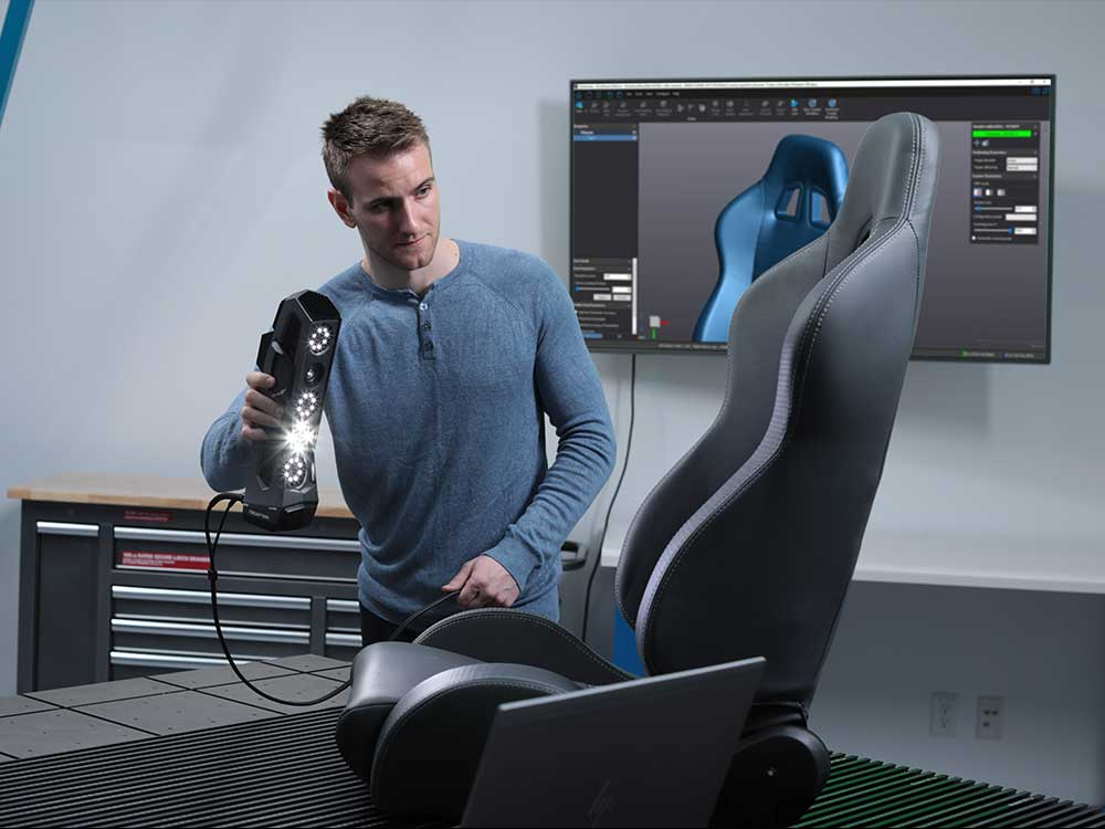 3D man holding go scan 3d device and scanning car chair in automotive industry
